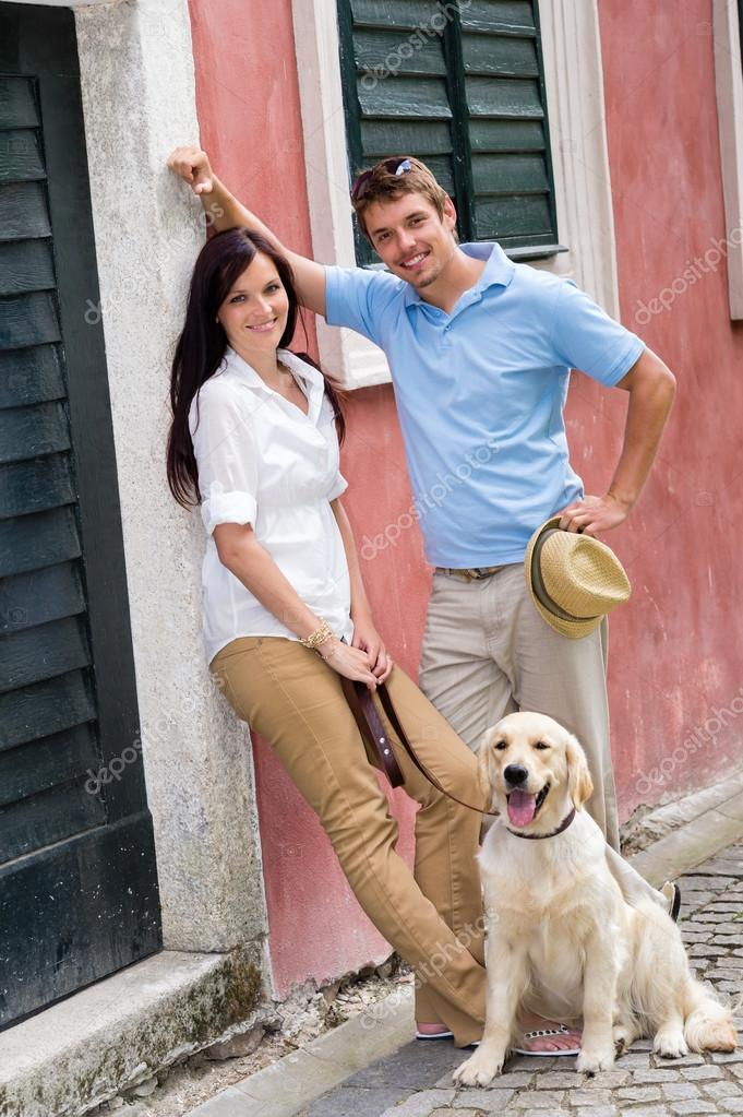 Modern couple with Labrador dog in the city  Stock Photo #12447707