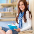 Happy student with notepad at high-school library — Stock Photo
