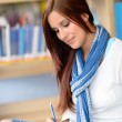 High school student at library make notes — Stock Photo