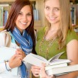 Girl friends student at high school library — Stock Photo