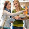 High school library happy student search book — Foto de Stock