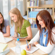 Group of students sitting at study room — Stock Photo