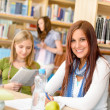 Stock Photo: Young girl studying at high school