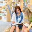 Stock Photo: High school library students sitting on stairs