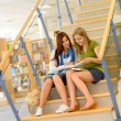 High school library students sitting on stairs — Stock Photo