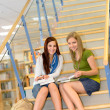 High school library students sitting on stairs — Стоковое фото