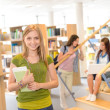 High school library teenage student in green — Stock Photo #12588706