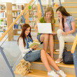 Group of high school classmates study library — Stock Photo