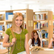 Smiling student girl leaving library high school — Stock Photo