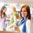 High school library student woman choose book — Stock Photo