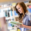 High school library student woman read book — Stock Photo
