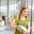 High school student read book by window — Stock Photo