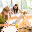 Group of students sitting at study room - Stock Photo