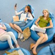 Group of students lying on beanbag relax — Stock Photo