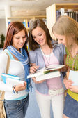 High school classmates with library books — Stock Photo