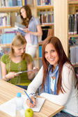 Young girl studying at high school — Stock Photo