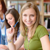 Smiling teenage student girl at study room — Stock Photo