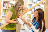 High school library student on stairs — Stock Photo
