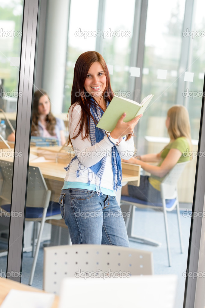Female teenager student reading book at high school study room — Stock Photo #12588832