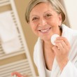 Senior woman hold cotton pad make-up removal — Stock Photo
