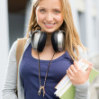 Young teenage student girl with books headphones — Stock Photo #12616744