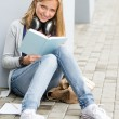 Stock Photo: Student reading book outside of school young