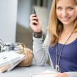 Student woman with notes and cellphone — Stock Photo