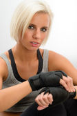 Kickbox woman put on protective gloves fitness — Stok fotoğraf