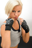 Woman ready to fight with kickbox gloves — Stock Photo