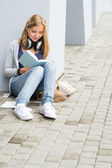 Teenage student girl study outdoor siting ground — Stock Photo