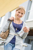 Student girl holding her books to school — Stockfoto