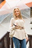 Young happy woman in rain with umbrella — 图库照片