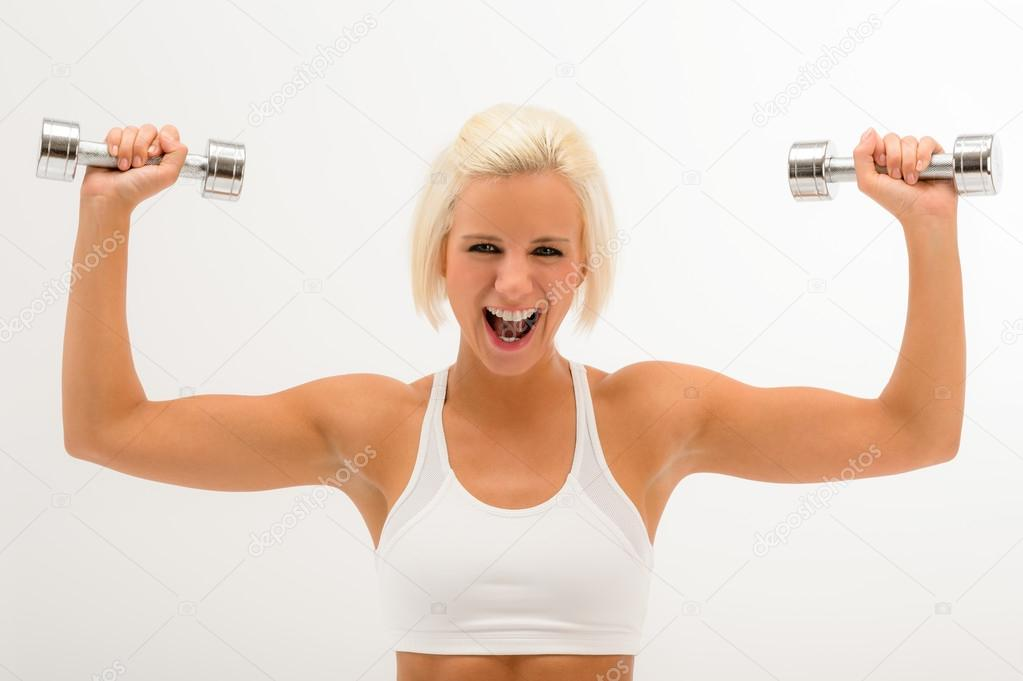 Shouting fitness woman lift dumbbells muscular arms isolated on white — Stock Photo #12615457
