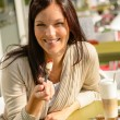 woman eating cheesecake at cafe bar happy — Stock Photo
