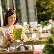 Woman looking at menu cafe bar terrace — Stock Photo