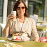 Woman drinking latte at cafe bar dessert — Stock Photo
