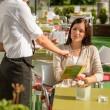 Waitress pointing menu woman in cafe bar — Stock Photo
