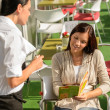 Woman order from waitress at cafe terrace - Foto Stock