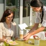 Waitress serve woman latte at cafe bar — Stock Photo