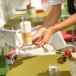 Waitress hands close up serving latte cafe - Foto Stock