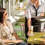 Waitress serve woman latte at cafe bar — Stock Photo #12729148