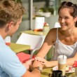 Couple flirting holding hands at cafe bar — Stock Photo