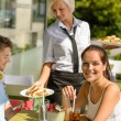 Waitress bring couple lunch food restaurant terrace — Stock Photo
