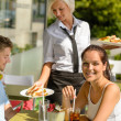 Waitress bring couple lunch food restaurant terrace — Stock Photo #12729213