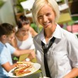 Waitress bringing sandwiches on plates fresh lunch — Stock Photo