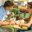 Stock Photo: Couple holding hands flirting at cafe happy