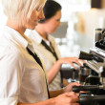 Waitresses at work make coffee machine cafe — Stock Photo