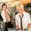 Stock Photo: Cafe waitress cashes in order bill register
