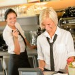 Cafe waitress cashes in order bill register - Stock Photo