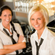 Cafe waitresses behind bar smiling at work — Stok fotoğraf